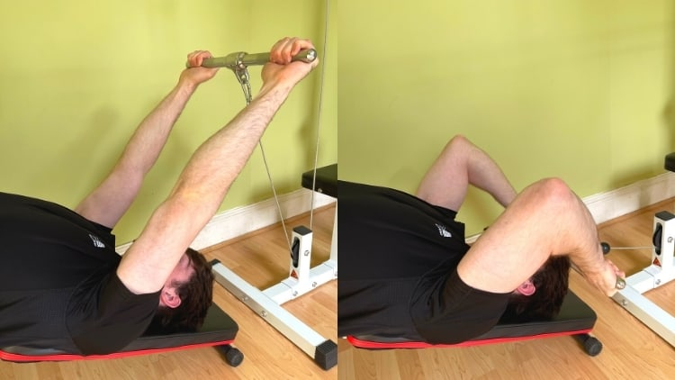 A man performing a decline triceps extension with cables