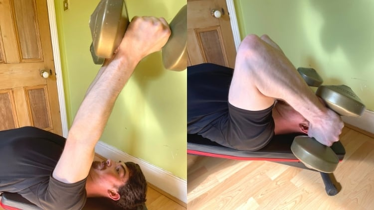 A man doing decline triceps extensions with dumbbells