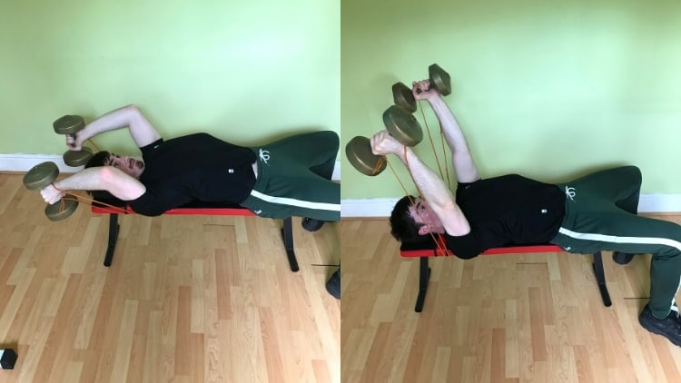A man doing dumbbell skull crushers with bands