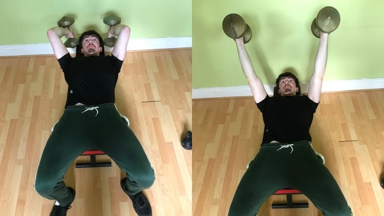 A man performing dumbbell skull crushers for his triceps