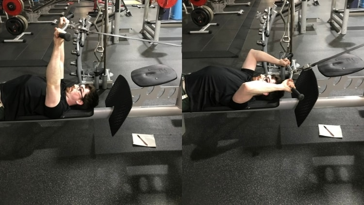 A man doing easy bar cable skull crushers on the seated row station