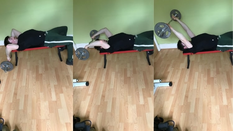 A man showing how to avoid getting elbow pain from skull crushers (lower the bar behind your head)