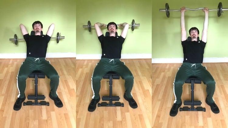 A man performing an EZ bar incline tricep extension