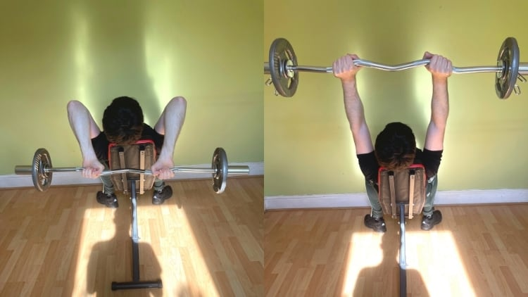 A man performing an EZ bar incline triceps extension