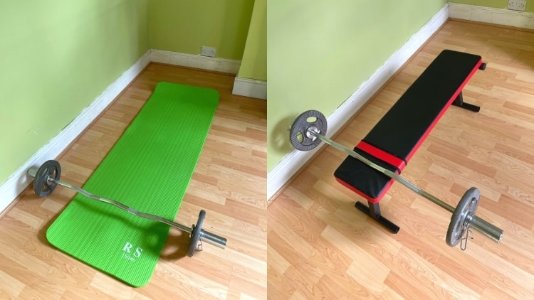 The setup for floor tricep extensions: a bar on an exercise mat