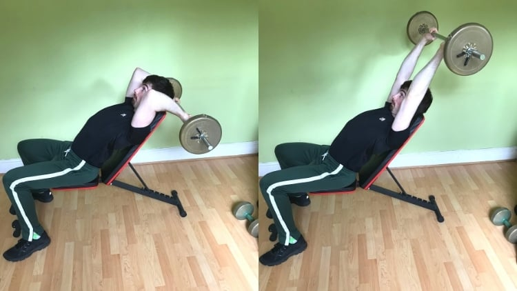 A man performing an incline barbell triceps extension