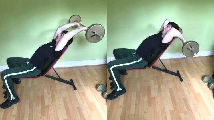 A man doing incline bench skull crushers to work his triceps