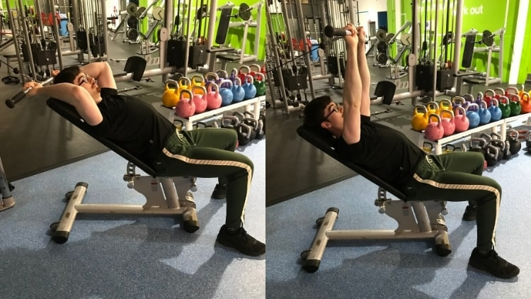 A man doing incline cable skull crushers at the gym
