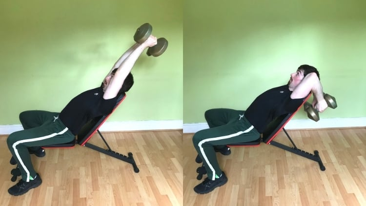 A man doing an incline dumbbell tricep extension during his workout