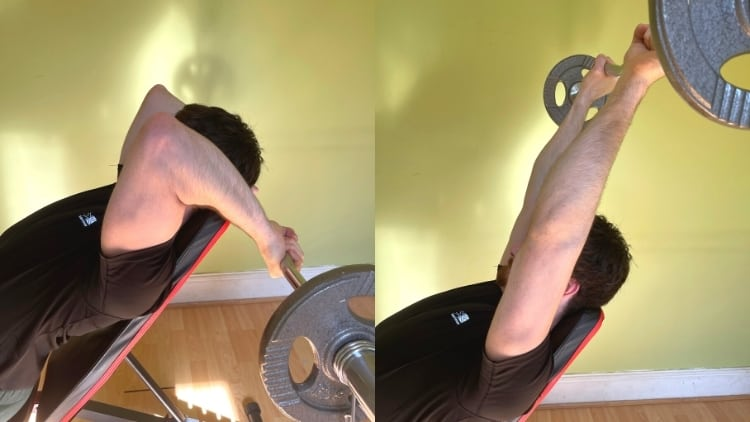 A man doing an incline EZ bar triceps extension