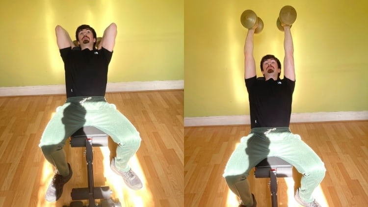 A man doing an incline overhead dumbbell extension to work his triceps