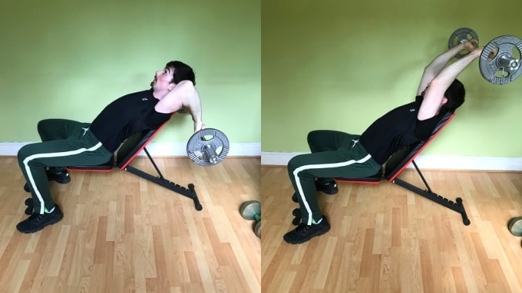 A man performing an incline skull crusher for his triceps