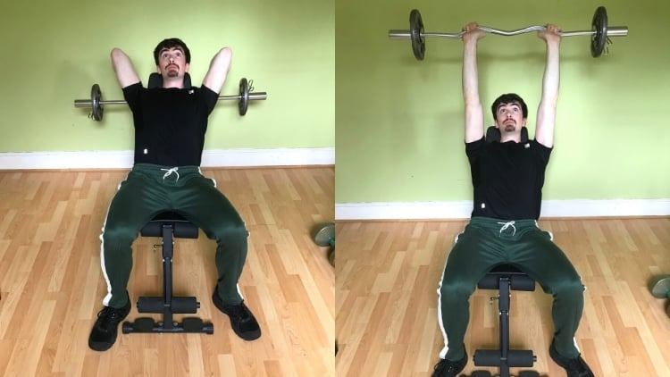 A man performing incline skull crushers for his triceps