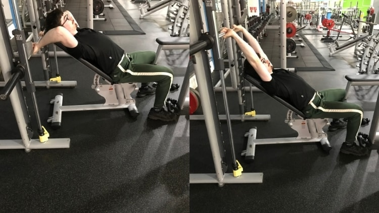 A man performing incline Smith machine skull crushers