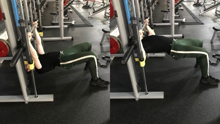 A man doing inverted rows