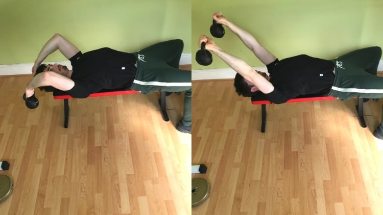 A man performing kettlebell skull crushers to work his triceps
