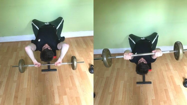 A man doing a lying barbell extension for his triceps