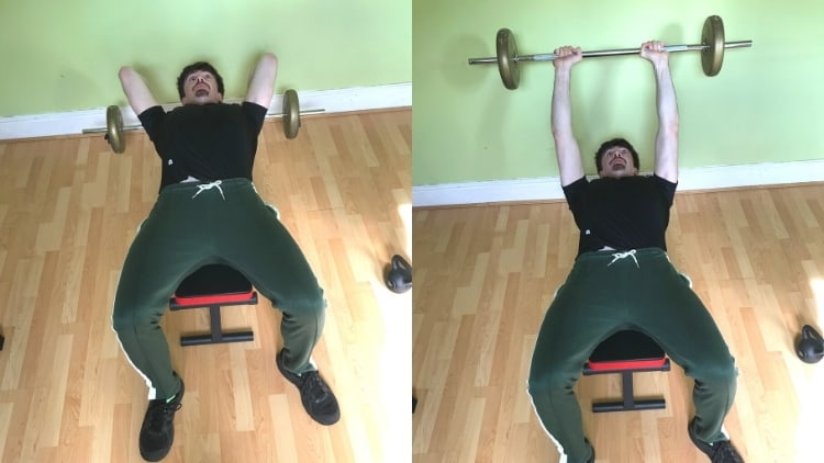 A man performing a lying barbell tricep extension