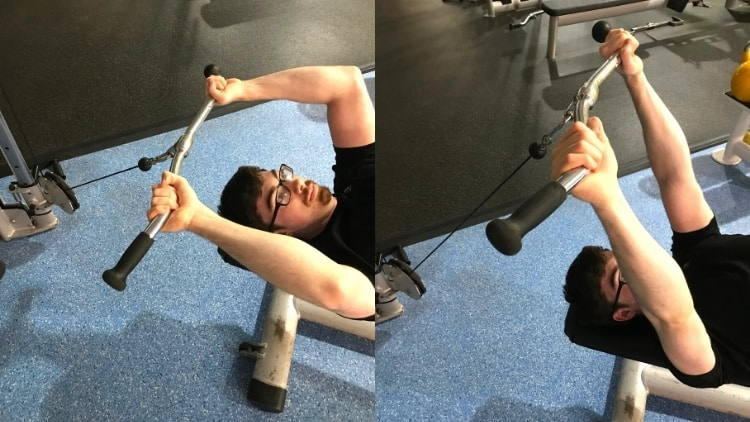 A man performing a lying cable extension for his triceps