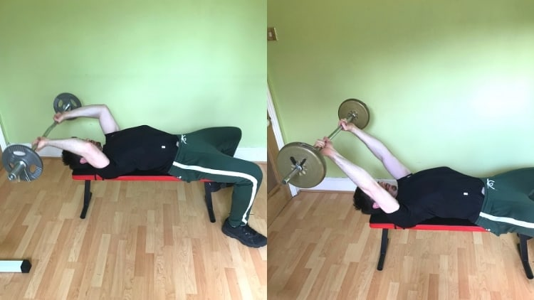 A man performing a lying down tricep extension with a bar