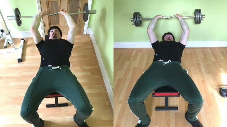 A man doing lying extensions for his triceps