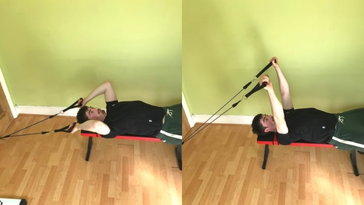 A man doing a lying resistance band tricep extension