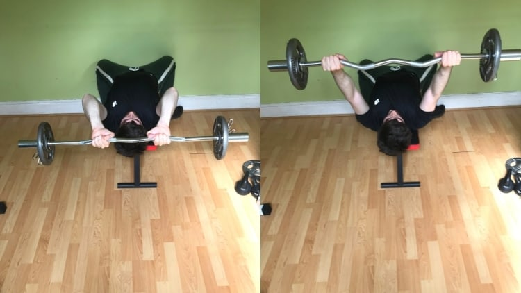 A man doing a narrow vs wide skull crushers comparison to demonstrate the differences