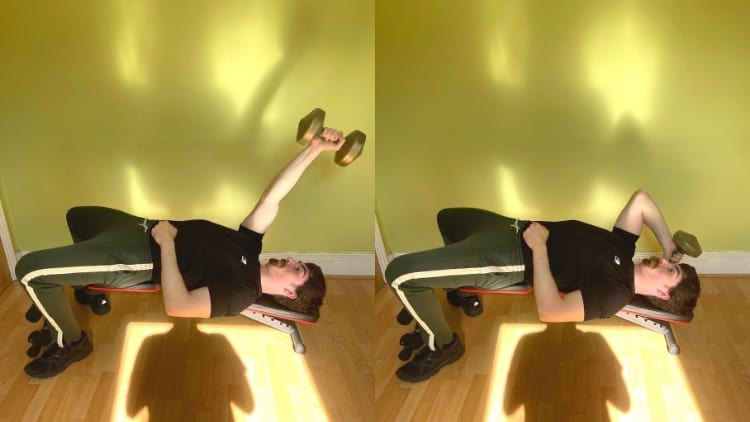 A man doing a one arm decline dumbbell tricep extension with a single weight