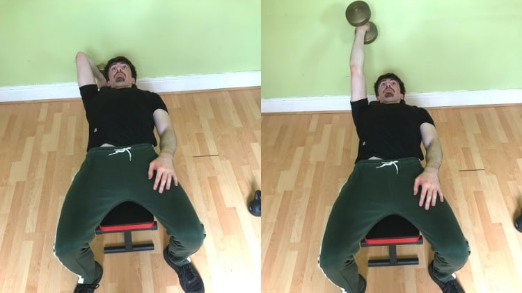 A man performing a one arm dumbbell lying triceps extension