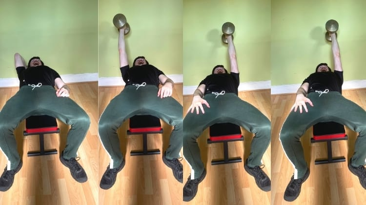 A man performing a one arm lying dumbbell tricep extension