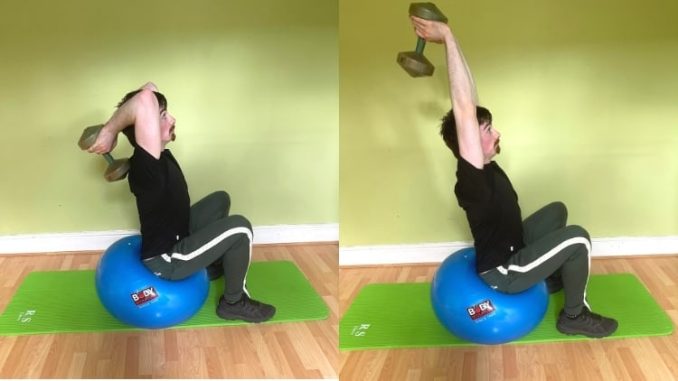 A man doing an overhead tricep extension on a stability ball