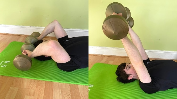 A man performing a pronted floor triceps extension on a mat