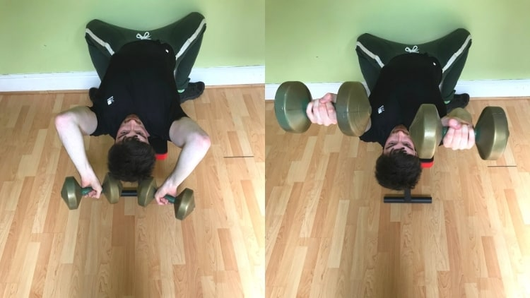 A man doing a pronated tricep extension with dumbbells