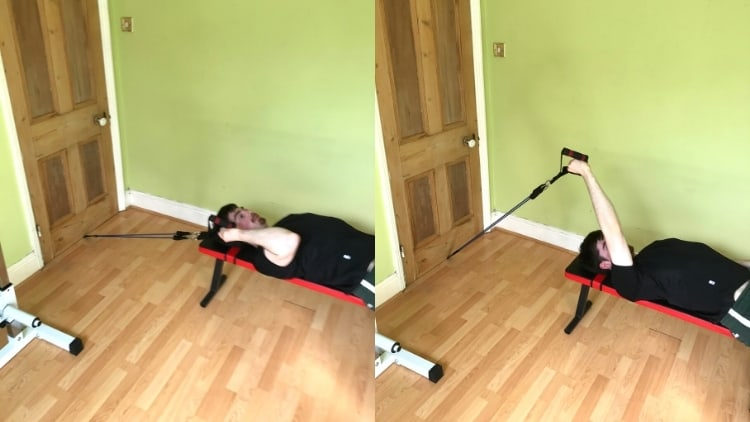 A man doing a resistance band single arm skull crusher