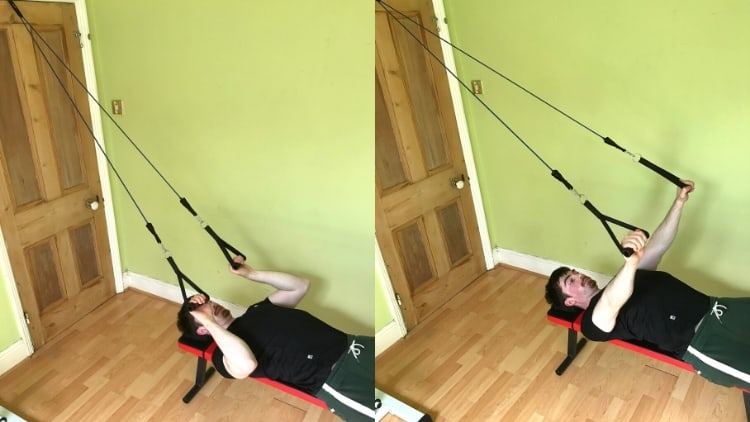 A man doing a resistance band skull crusher
