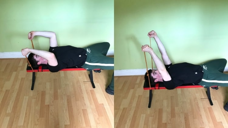 A man performing resistance band skull crushers for his triceps