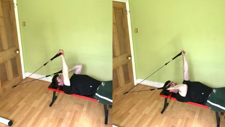 A man performing resistance band skull crushers