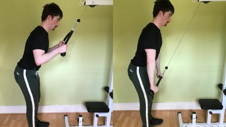 A man performing a cable rope pushdown for his triceps