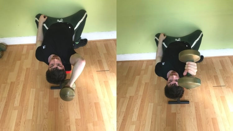 A man doing a single arm lying tricep extension