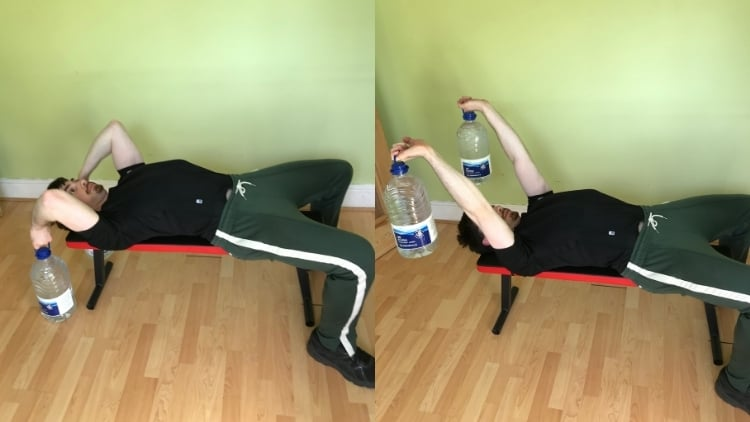 A man demonstrating a suitable skull crusher alternative for the triceps