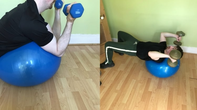 A man doing a skull crusher on an exercise ball