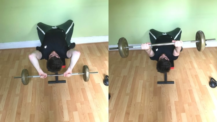 A man performing skull crushers with a barbell
