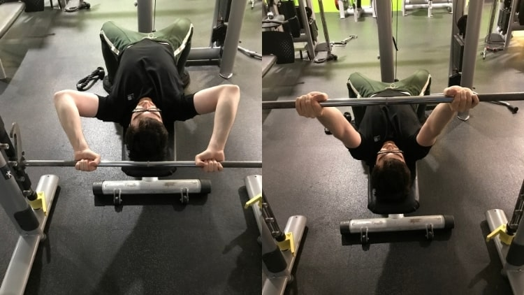 A man doing some skull crushers on a Smith machine