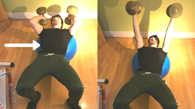 A man performing skull crushers on a stability ball