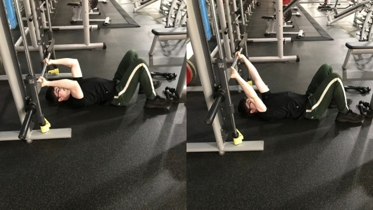 A man performing Smith machine floor skull crushers