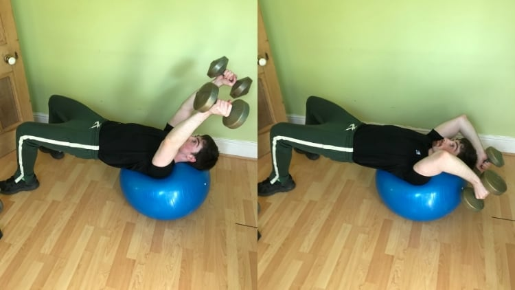 A man performing a stability ball skull crusher
