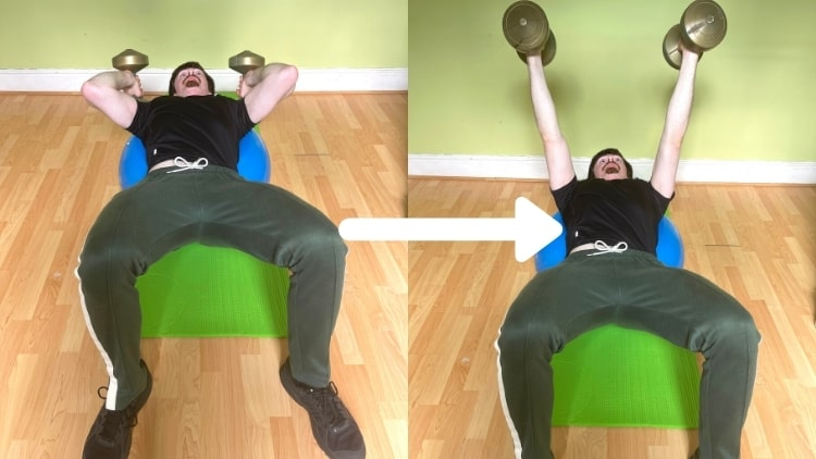 A man doing a Swiss ball tricep extension with dumbbells