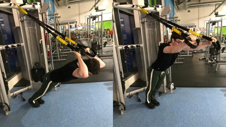 A man performing a TRX French press at the gym
