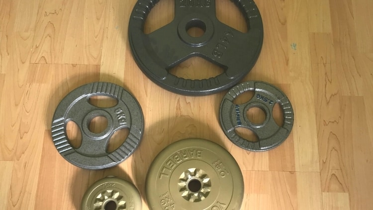 A collection of weight plates on the floor