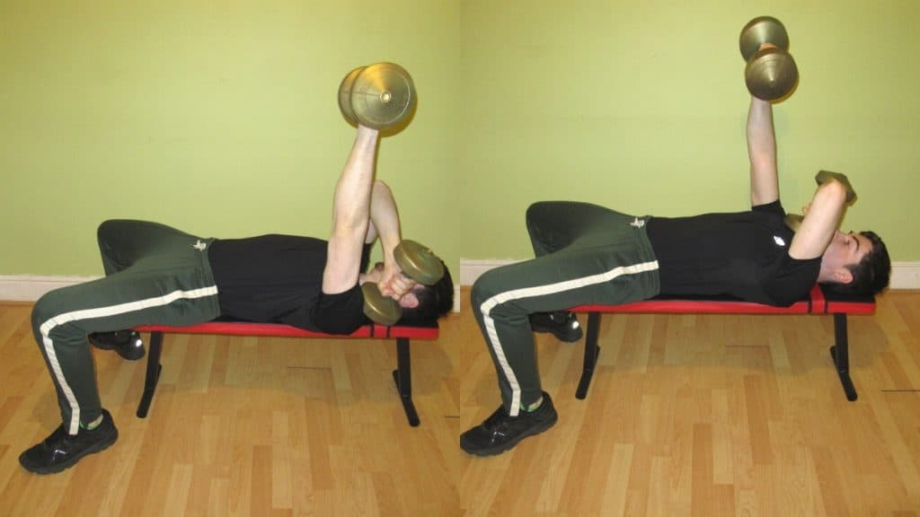 A man doing an alternating cross body triceps extension with dumbbells